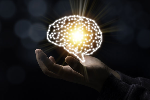 Glowing Brain in Hand to represent brain training with IOT devices and mobile apps