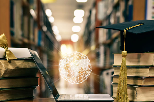 Image of laptop, globe orb, college library, stack of books, and graduation cap to showcase data integration work for higher ed college by Chateaux